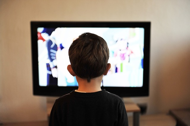 Autistic child watches Netflix on TV